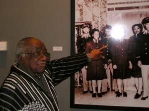 Kenneth Wright, a G. Fox & Company elevator operator, points to his own photo with co-workers. Wright retired in 1980.