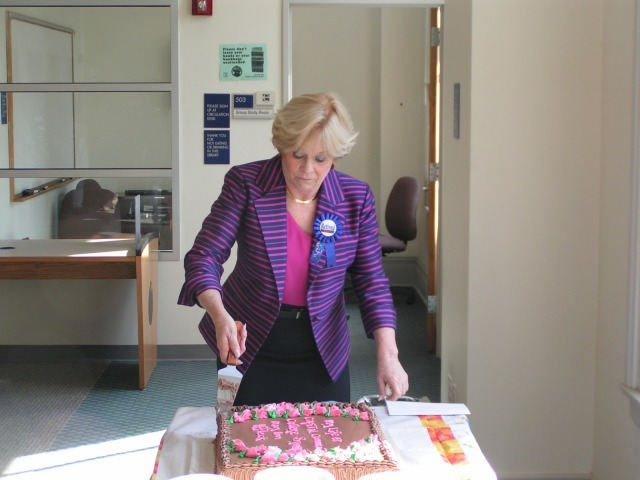 Academic Dean Mary Ann Affleck cuts her cake at dedication of a Window To The Future in her honor at the Arthur C. Banks, Jr. Library.