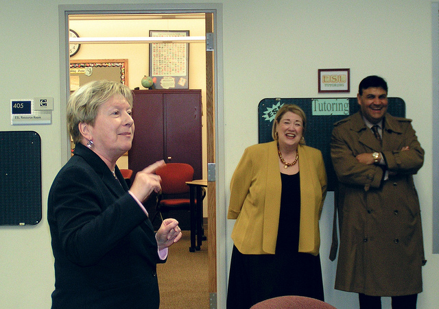 Northwestern Community College President Barbara Douglas (left) speaks at April 9th Window To The Future reception for Nancy Caddigan (center). Douglas formerly served as Provost (Academic Dean) at Capital.  At right is Travelers Vice President Carlos Figueroa. (McPhoto)