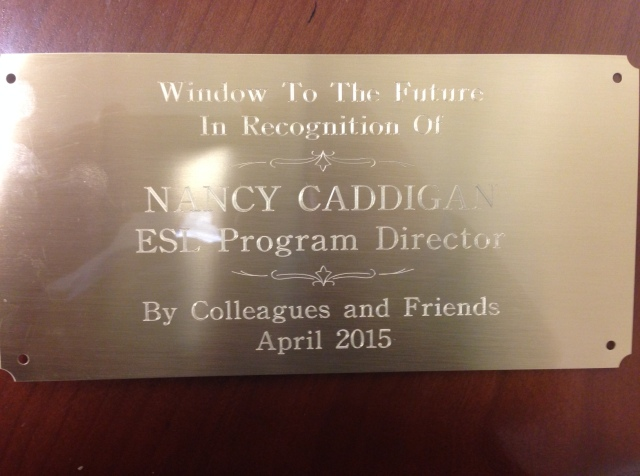 A Window To The Future plaque permanently recognizes the ESL  work of Nancy Caddigan. It  will be mounted next to a fourth floor Main Street window where the ESL lab is located.  (McPhoto)