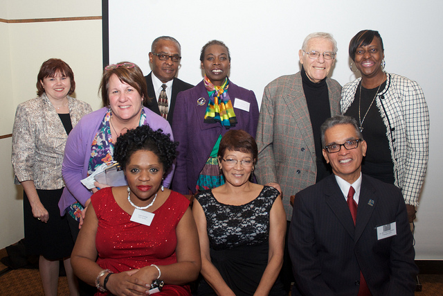 Phil Knecht (standing second from right) at a Changing Lives Gala.