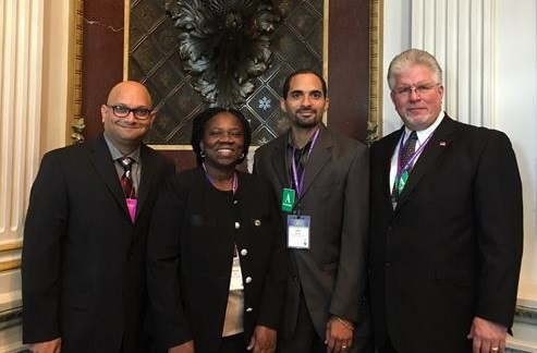 Attending the White House Symposium for Computer Science last October were UCONN Associate Math Professor Amit Savkar, Chinma Uche, Math and CS teacher at Hartford's Academy of Aerospace and Engineering High School, Capital Associate Professor Seth Freeman and Avon Schools' Superintendent Gary S. Mala. (Photo courtesy of Avon Public Schools)