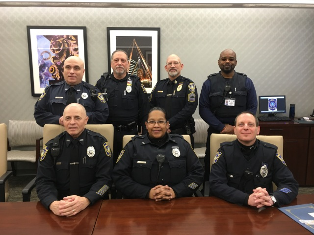 Capital's public safety officers received medals and awards January 24th. Front row from left: Jose Agosto, Carmen Escobar and Scott Dorio. Back row from left: Paul Divolo, Joel White, James Griffin and Marcus Thomas.